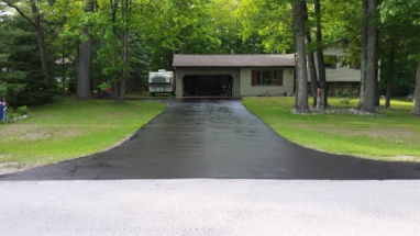 Long driveway with sealcoating